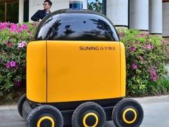苏宁自动送货机器人亮相:主动避让行人/会坐电梯