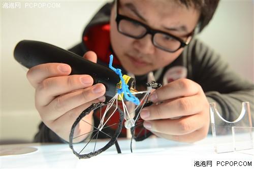 联想创客跨年展-3d打印笔制作的玩具自行车